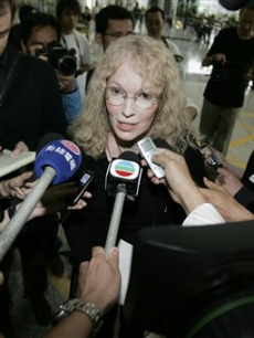 Mia Farrow speaks to the press as she arrives in Hong Kong, May 1, 2008