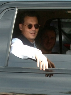 Johnny Depp rides to a scene of his upcoming movie 'Public Enemies'