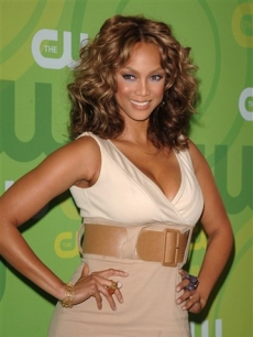 Tyra Banks poses on the green carpet at an event for The CW