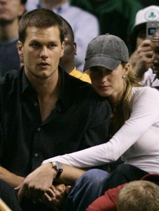 Tom Brady and Gisele cuddle at the Celtics-Pistons game
