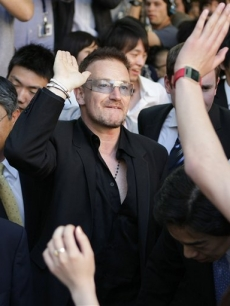 Bono at a ceremony to confer the degree of doctor of laws for Bono at Keio University in Tokyo