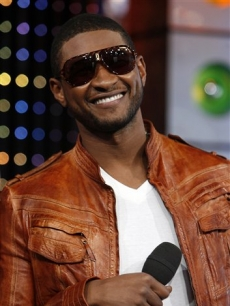 Usher smiles during an appearance on &#8216;TRL,&#8217; May 27, 2008 
