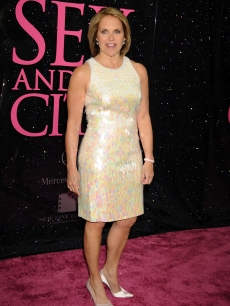Katie Couric strikes a pose on the &#8216;Sex and the City&#8217; pink carpet