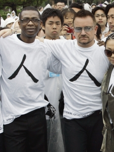 Bono and international musicians at the One for All event in Tokyo