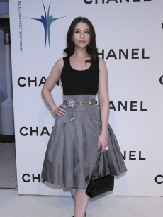 Michelle Trachtenberg poses for pictures at the Chanel gala