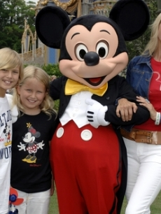 Christie Brinkley, son Jack, & daughter Sailor with Mickey in Disneyland
