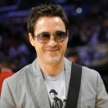 A happy Robert Downey Jr. is seen at halftime during Game 5 of the NBA basketball finals