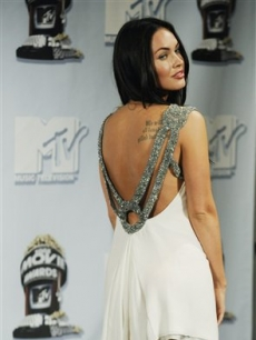 Megan Fox poses backstage at the MTV Movie Awards