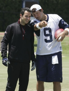 Helio Castroneves and Cowboys quarterback Tony Romo at a practice session