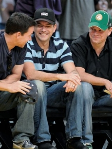 Mark Wahlberg, a friend and Matt Damon at Game 5 of the NBA basketball finals