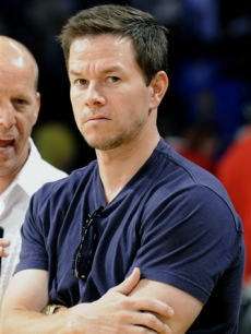 A scowling Mark Wahlberg is seen at halftime during Game 5 of the NBA basketball finals