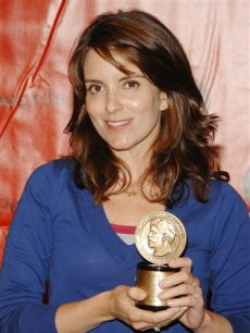 Tina Fey poses with her Peabody Award for the television series '30 Rock'
