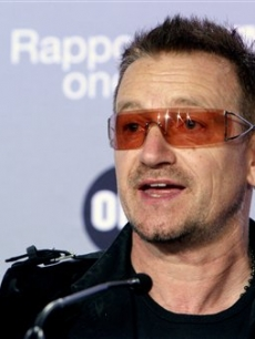U2 lead singer and activist Bono at a news conference in Paris for aid for Africa