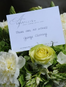 George Clooney sends flowers and a card to Tim Russert's wake