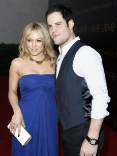 Hilary Duff (in Phillip Lim) and Mike Comrie arrive to the Cartier party