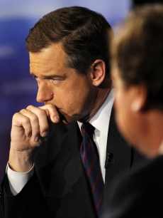 Brian Williams (withTim Russert in the foreground)