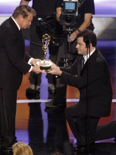 Jimmy Kimmel presents Regis Philbin with the Lifetime Achievement Award at the Daytime Emmys