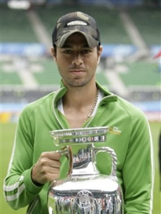 Enrique Iglesias poses with the Euro 2008 trophy in the Ernst Happel Stadium in Vienna, Austria