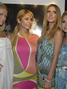 Paris, a friend, Nicky and Kathy Hilton pose together at a charity auction in LA