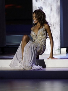 usaCrystle Stewart, Miss USA, falls down during the evening gowns segment of Miss Universe 2008