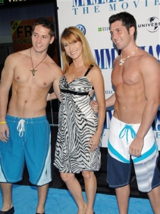Jane Seymour hangs out with some shirtless gents at the 'Mamma Mia' premiere