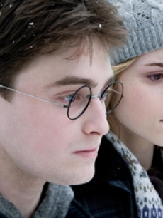 Daniel Radcliffe as Harry Potter and Emma Watson as Hermione Granger