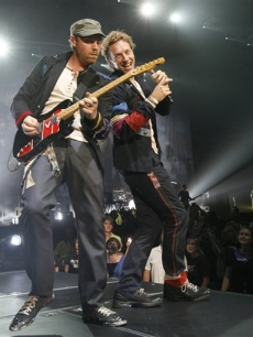 Coldplay's Chris Martin and Jonny Buckland perform at the Air Canada Centre in Toronto