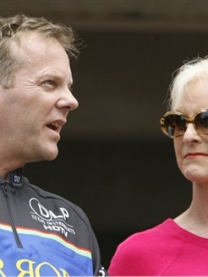 Just another day at the race track for Kiefer Sutherland and Cindy McCain, chatting before the NASCAR Sprint Cup Series Pennyslvania 500 auto race