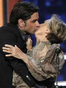John Stamos plants a kiss on Cloris Leachnman at the 'Comedy Central Roast of Bob Saget'