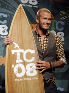 David Beckham poses with his surfboard for Choice Male Athlete