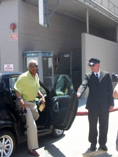 Bill Cosby steps out of a Smart Car on the NBC lot in Burbank