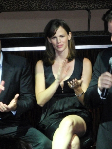 Ben Affleck and Jennifer Garner look on as Matt Damon gives a speech at the fundraiser