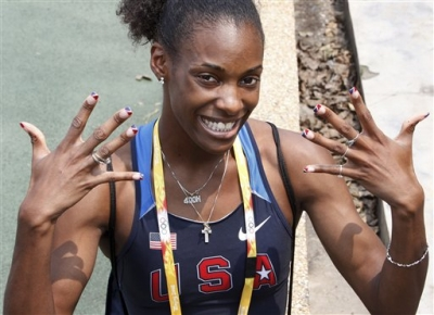 U.S. women's 400-meter runner Dee Dee Trotter shows off her U.S. team colored nails during her morning practice, August 4, 2008