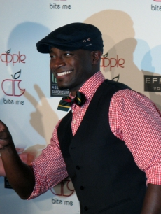 Taye Diggs sneaks in a quick peace sign