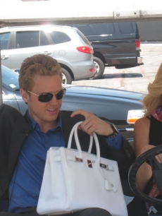 Spencer Pratt holds Heidi Montag's purse before they motor around the NBC Lot with Access Hollywood