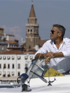 George Clooney arrives in Venice, Italy on a taxi boat for the 65th Venice Film Festival