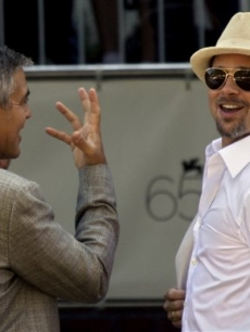 George Clooney shares a joke with Brad Pitt at the 65th edition of the Venice Film Festival