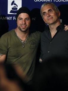 Musicians Chris Daughtry, left, and Art Alexakis pose together at the GRAMMY's Rock The Conventions concert in Denver, late Tuesday Aug. 26, 2008
