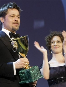Brad Pitt wins the award for Best Actor at the Venice Film Festival