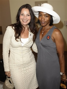 Actresses Fran Drescher, left, and Angela Bassett pose together during the Capitol File Magazine/Viacom luncheon honoring Marian Wright Edelman in Denver, Wednesday, Aug. 27, 2008