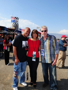 Maurice Greene, Cheryl Burke and Ron Perlman share a NASCAR moment in Fontana, Calif.