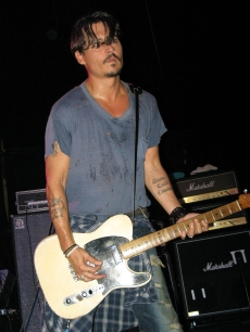 Johnny Depp performs with his band The Kids in Florida