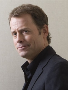 Greg Kinnear poses for a photo following a interview at the Toronto Film Festival