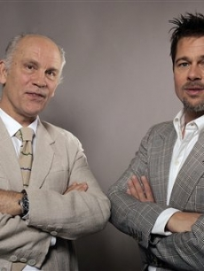 'Burn After Reading' cast members John Malkovich and Brad Pitt pose for a photo at the Toronto Film Festival
