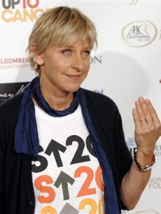 Ellen DeGeneres shows off her wedding ring at the Stand Up to Cancer benefit in LA