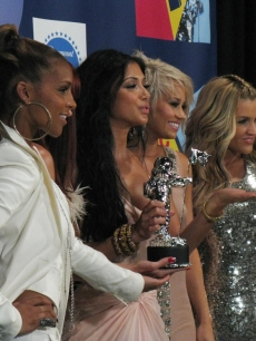 The Pussycat Dolls smile backstage at the VMAs