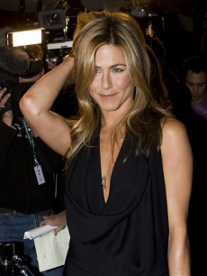 Jennifer Aniston walks the red carpet as she arrives for the film 'Management' during the 2008 Toronto International Film Festival