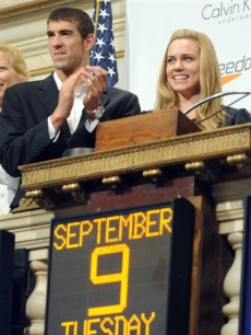 Olympic gold medalists Michael Phelps and Natalie Coughlin at the New York Stock Exchange