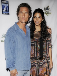 Matthew McConaughey, star of 'Surfer, Dude,'  with his girlfriend Camila Alves at the premiere