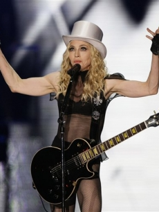 Madonna performs on stage as part of her &#8216;Sticky and Sweet&#8217; tour at Wembley Stadium in London
